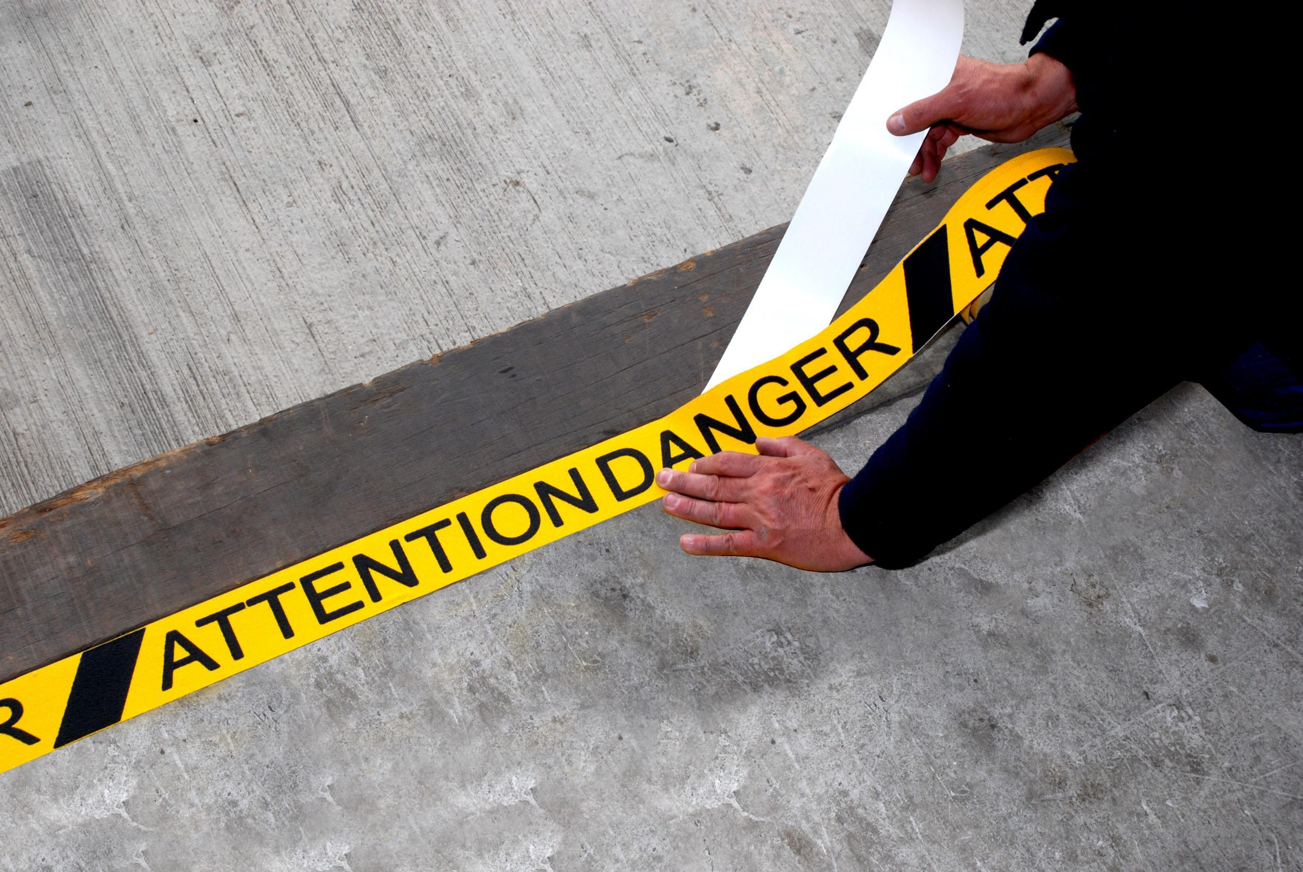 _305377831H3417-Attention-Danger-Printed-Anti-Slip-Warning-Tape-Being-Applied-50mm-1